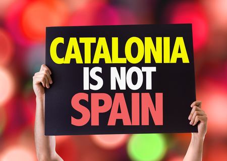 seperation: Hands holding blackboard with Catalonia Is Not Spain on bokeh background Stock Photo