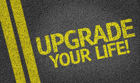 upgrading: Upgrade Your Life on tar road Stock Photo