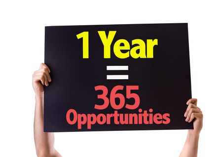 one year: Hands holding blackboard with One Year Equals 365 Opportunities on white background