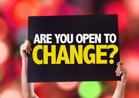 be the change: Hands holding blackboard with Are You Open To Change on bokeh background