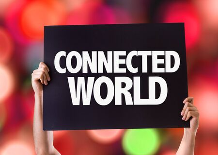 connected world: Hands holding card with Connected World on bokeh background