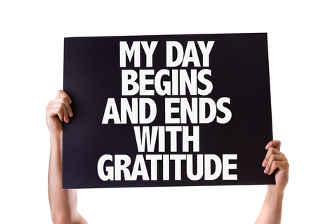the ends: Hands holding blackboard with My Day Begins And Ends With Gratitude on white background