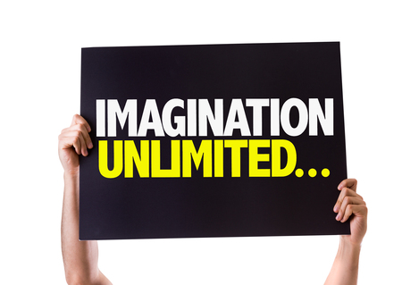 unlimited: Hands holding card with text Imagination unlimited on white background