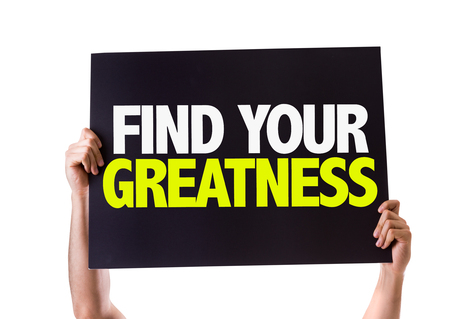 greatness: Hands holding blackboard with Find Your Greatness on white background