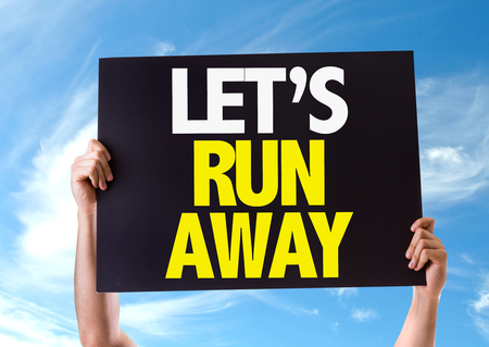 run away: Hands holding blackboard with Lets Run Away on sky background Stock Photo
