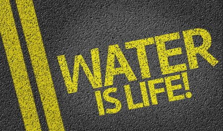 Water Is Life on tar road