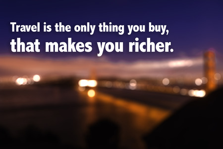 richer: Travel is the only thing you buy that makes you richer on blurred background Stock Photo
