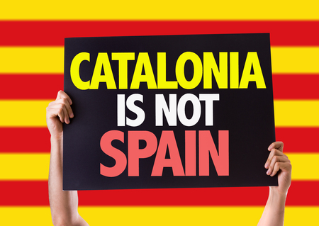 seperation: Hands holding blackboard with Catalonia Is Not Spain on striped background
