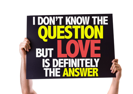 i dont know: Hands holding blackboard with I Dont Know The Question But Love Is Definitely The Answer on white background Stock Photo
