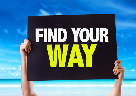 find your way: Hands holding blackboard with Find Your Way on beach background Stock Photo