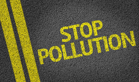 stop pollution: Stop Pollution on tar road Stock Photo