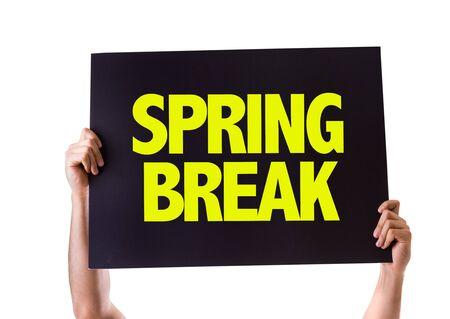 springbreak: Hands holding blackboard with Spring Break on white background