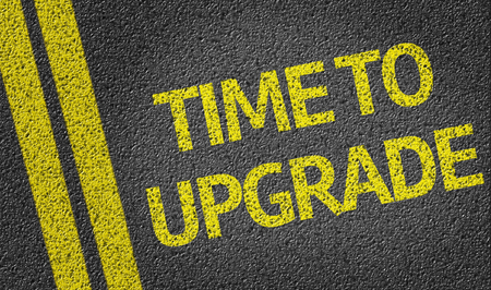 go for: Time To Upgrade on tar road Stock Photo
