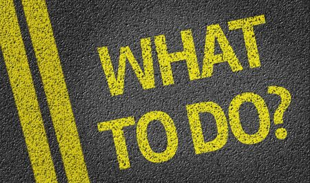 road surface: What to do text on road surface Stock Photo