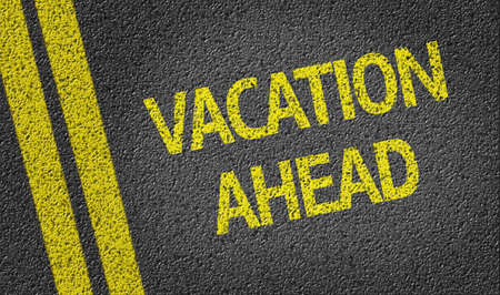 ahead: Vacation ahead text on road surface Stock Photo