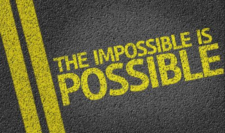 road surface: The impossible is possible text on road surface