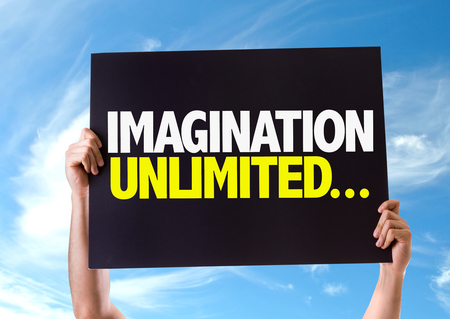 unlimited: Hands holding card with text Imagination unlimited on sky background