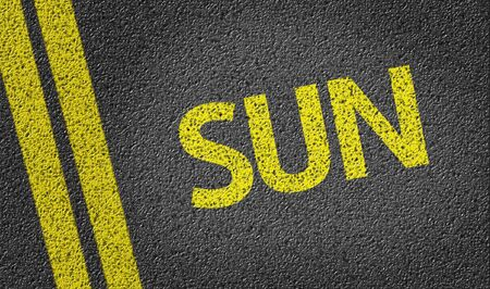 road surface: Sun text on road surface