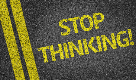 road surface: Stop thinking text on road surface