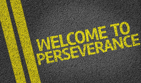 road surface: Welcome to perseverance text on road surface