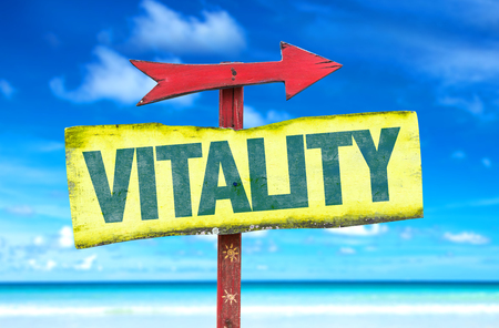 vitality: Signpost with the text Vitality on beach background