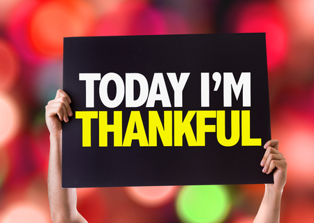 relieved: Hands holding card with text Today Im thankful on bokeh background Stock Photo