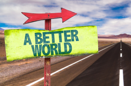 better: Signpost with the text A better world on road background Stock Photo