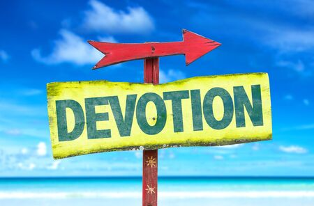 the devotion: Signpost with text Devotion on beach background Stock Photo