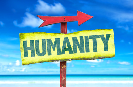 human beings: Signpost with text Humanity on beach background Stock Photo