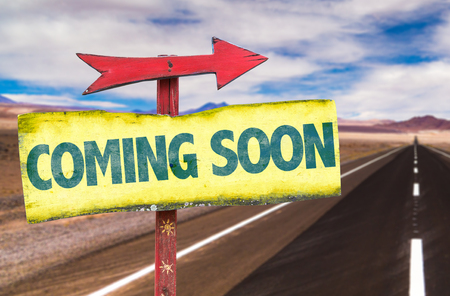 anticipate: Signpost with text Coming soon on road background
