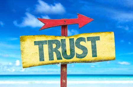 believing: Trust sign with arrow on beach background
