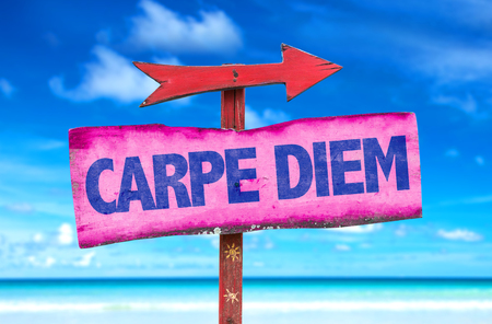 carpe diem: Carpe Diem sign with arrow on beach background