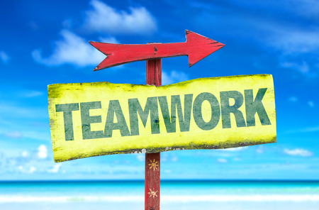 common goals: Teamwork sign with arrow on beach background