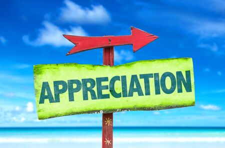 thankfulness: Appreciation sign with arrow on beach background Stock Photo