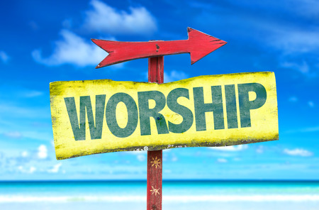 glorification: Worship sign with arrow on beach background Stock Photo