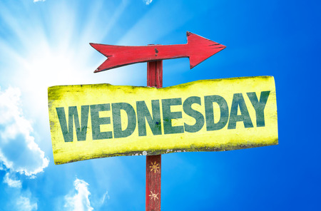 wednesday: Wednesday sign with arrow on sunny background