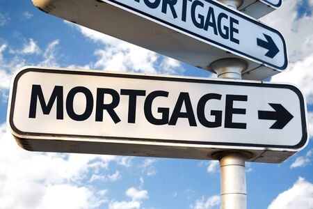 loaning: Mortgage sign with clouds and sky background