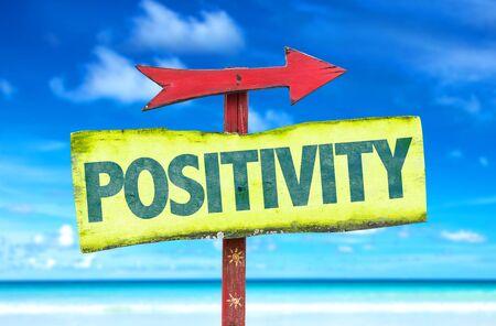 positivity: Positivity sign with arrow on beach background