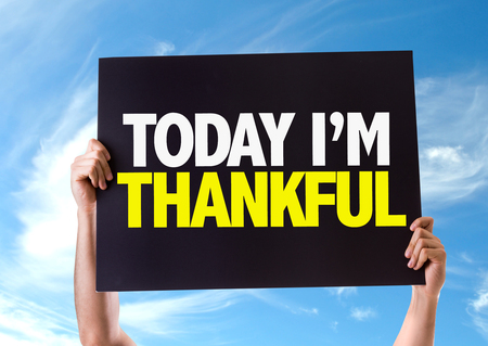 relieved: Hands holding blackboard with Today Im Thankful on sky background Stock Photo