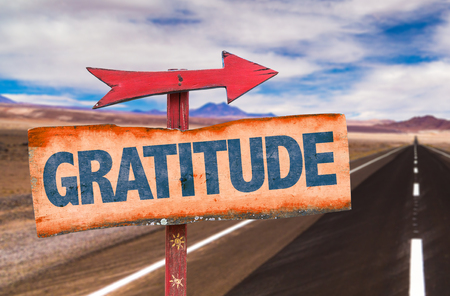arrow sign: Gratitude sign with arrow on a highway background Stock Photo