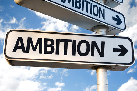 ambition: Ambition sign with clouds and sky background Stock Photo