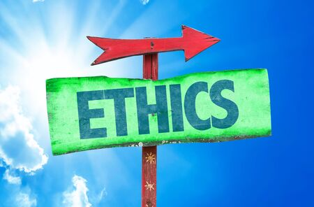 valores morales: Ethics sign with arrow on sunny background