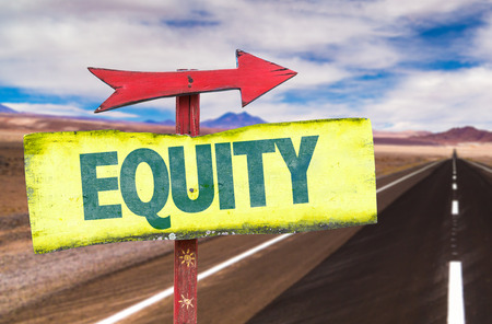 equity: Equity sign with arrow on a highway background Stock Photo