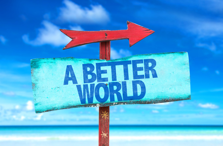 better: A Better World sign with arrow on beach background