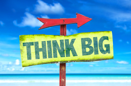 think big: Think Big sign with arrow on beach background