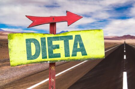 dieta: Diet in Spanish on sign with arrow on a highway background