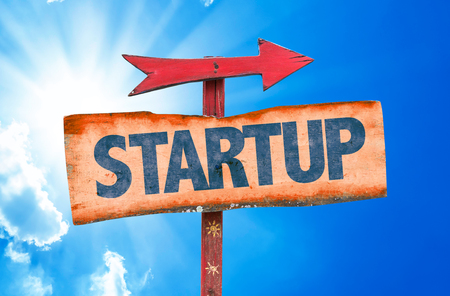 entrepeneur: Startup sign with arrow on sunny background
