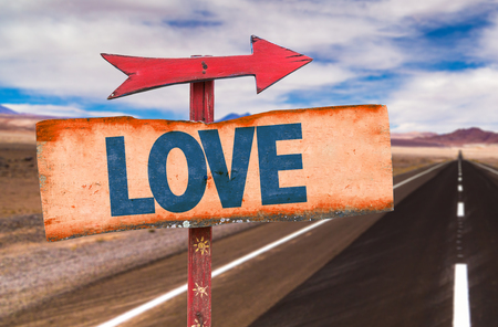 highway love: Love sign with arrow on a highway background