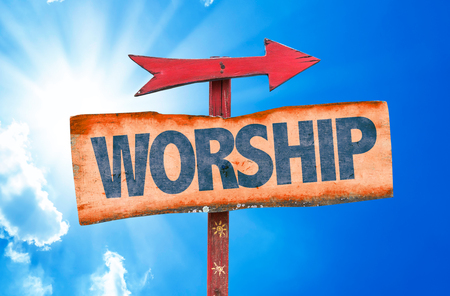 glorification: Worship sign with arrow on sunny background