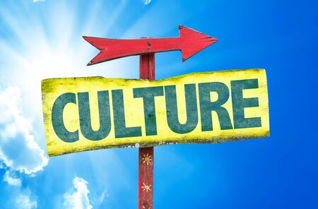 educative: Culture sign with arrow on sunny background Stock Photo